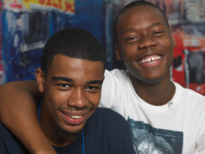 Two more teens smiling