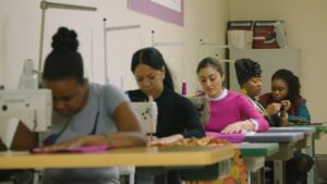 Custom Collaborative co-op workers creating fashion pieces in New York City.